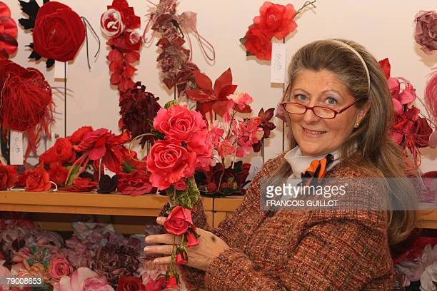 Recent picture of Marcelle Guillet an artificial flowers designer posing with one of her creations in her showroom in Paris in December 2007 it was...