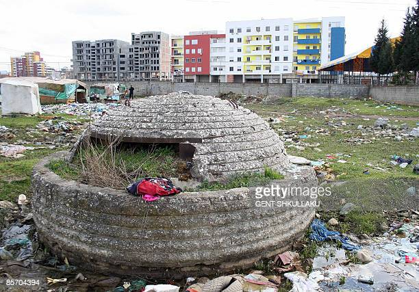Recent picture showing a decrepit bunker from the old communist times lying in the midst of garbage in front of new buildings erected in recent years...
