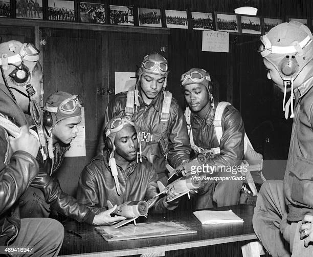 Recent pilot graduates from Tuskegee Army Flying School practice manoeuvres with model planes Tuskegee Alabama 1943