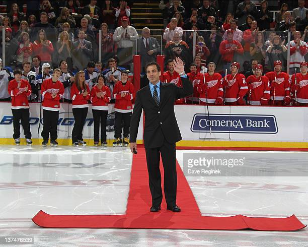 Recent US Hockey Hall of Fame inductee Chris Chelios drops the game puck before an NHL game between the St Louis Blues and the Detroit Red Wings at...