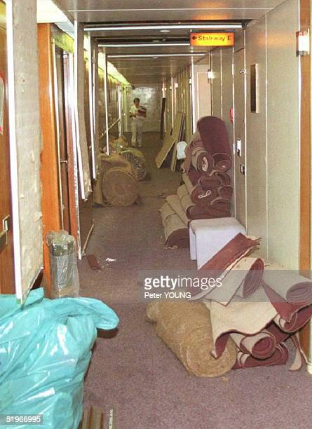 A recent view below deck on the QE2 shows carpets rolled up in the hallway during a midvoyage refit of the floors and wiring Passengers protested...