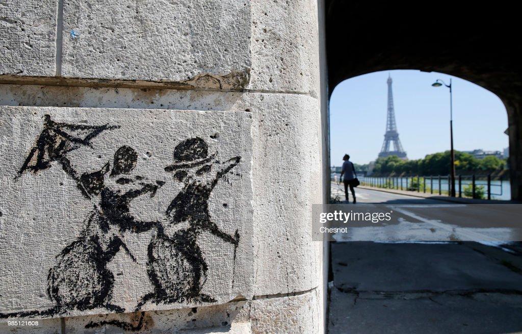British Graffiti Artist Banksy Puts Up  New Works In Paris : News Photo