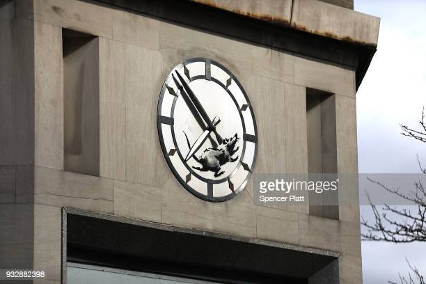 A recent work by the elusive British street artist Bansky shows a rat on the clock on the front of an old bank building at the corner of 14th Street...