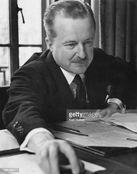 Recently appointed British Minister of Information Alfred Duff Cooper in his office, May 1940. Original publication: Picture Post - 287 - Alfred Duff...