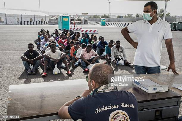 Recently arrived and rescued North African men in Sicily await processing by Italian immigration authorities on October 15 2014 For all these...
