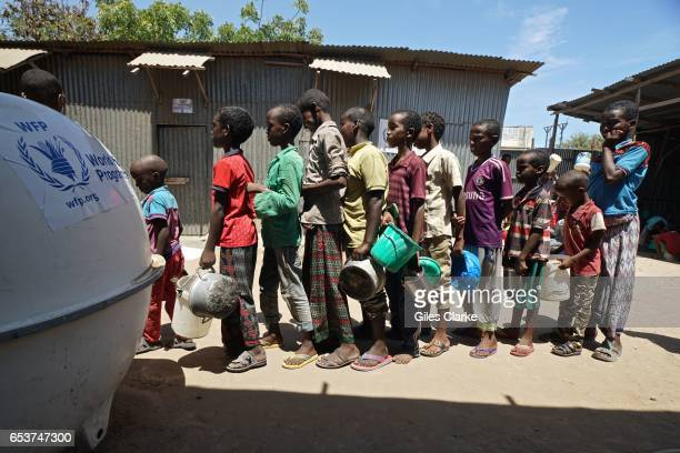 Recently arrived internally displaced children wait in a 'wetfood' line at a World Food Program center in Mogadishu Somalia Thousands of people have...