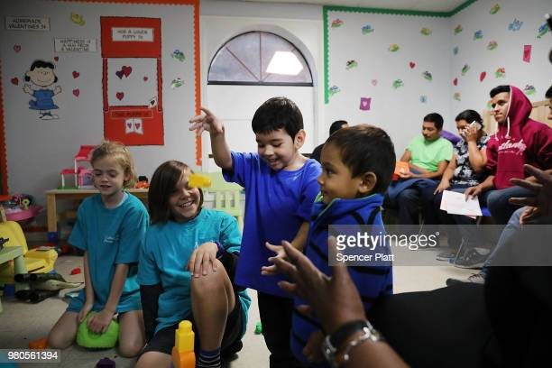 Recently arrived migrant children play with family and volunteer children at the Catholic Charities Humanitarian Respite Center on June 21, 2018 in...