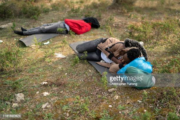 Recently arrived migrants sleep in an olive grove that has become a makeshift camp next to the overcrowded Moria Refugee Camp on October 17 2019 in...