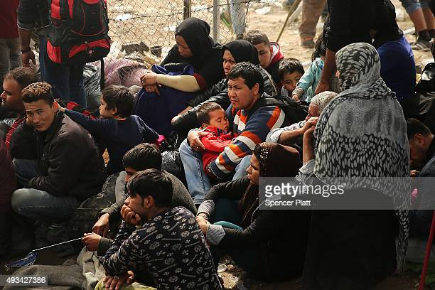 Recently arrived migrants wait to be processed at the increasingly overwhelmed Moria camp on the island of Lesbos on October 20 2015 in Mytilene...