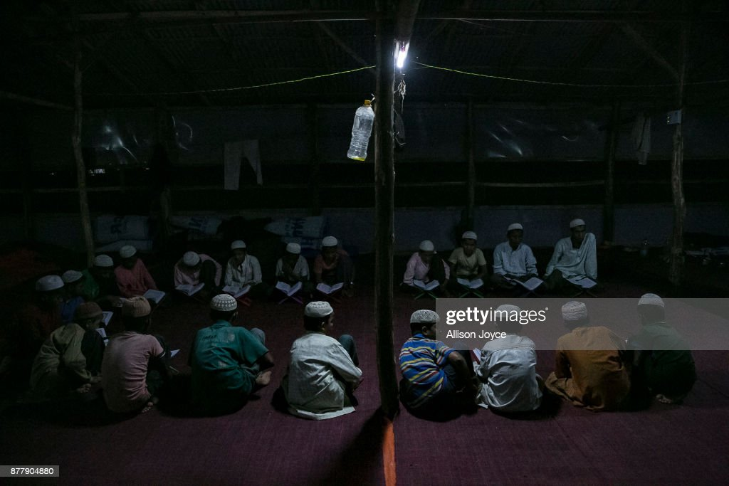 COX'S BAZAR, BANGLADESH - NOVEMBER 23: Recently arrived Rohingya refugees are seen studying the Koran in Kutupalong camp on November 23, 2017 in Cox's Bazar, Bangladesh. Myanmar and Bangladesh signed a deal on Thursday to repatriate hundreds of thousands of Rohingya Muslims who have flooded into Bangladesh during the brutal crackdown on the Rohingya minority. Over 620,000 Rohingya have fled their homes since the crackdown began late August, which has been termed as 'ethnic cleansing' by the UN and the US.