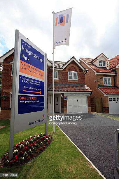 Recently constructed homes built by George Wimpey part of TaylorWimpey PLC wait to be bought at one of the company's developments on 3 July 2008 in...