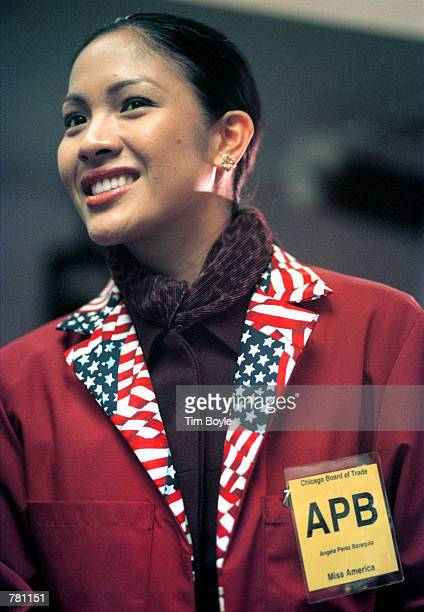 Recently crowned Miss America Angela Perez Baraquio of Honolulu attends trading day at the Chicago Board of Trade October 23 2000 in Chicago Baraquio...