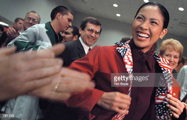 Recently crowned Miss America Angela Perez Baraquio of Honolulu receives applause while modeling her trading jacket at the Chicago Board of Trade...