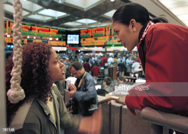 Recently crowned Miss America Angela Perez Baraquio of Honolulu speaks with a trader at the Chicago Board of Trade October 23 2000 in Chicago...