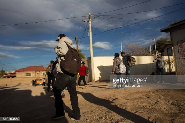 Recently deported migrants walk near to the US/Mexico border in Nogales on February 16 northwestern Mexico ***Attention Editors this image is part of...