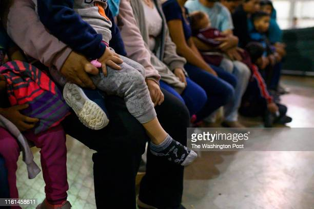 Recently detained migrants, many of them family units, sit and await processing in the US Border Patrol Central Processing Center in McAllen, Texas...