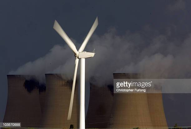 Recently installed wind turbines generate electricty in the shadow of Drax Europe's biggest coal fired power station on August 24 2010 in Selby...