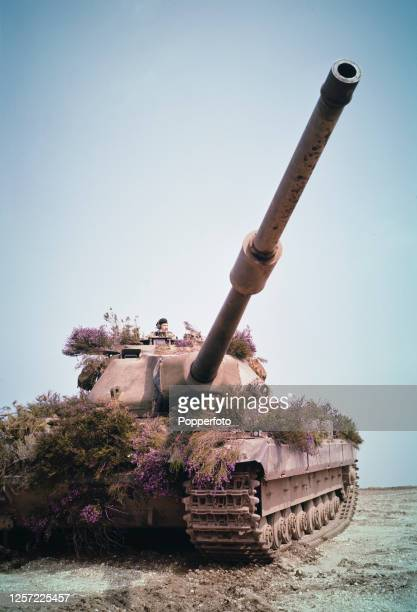 A recently introduced British Army Conqueror heavy tank and crew with camouflage on a training exercise in July 1956