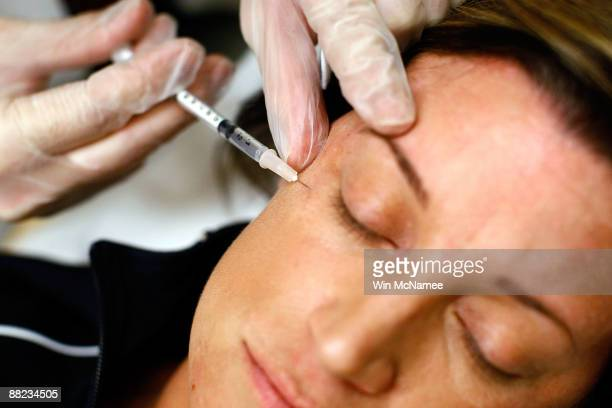 Recently laid off worker Lyn Talent receives a free Botox injection during an event called the The Botox Bailout where the first 50 recently laidoff...