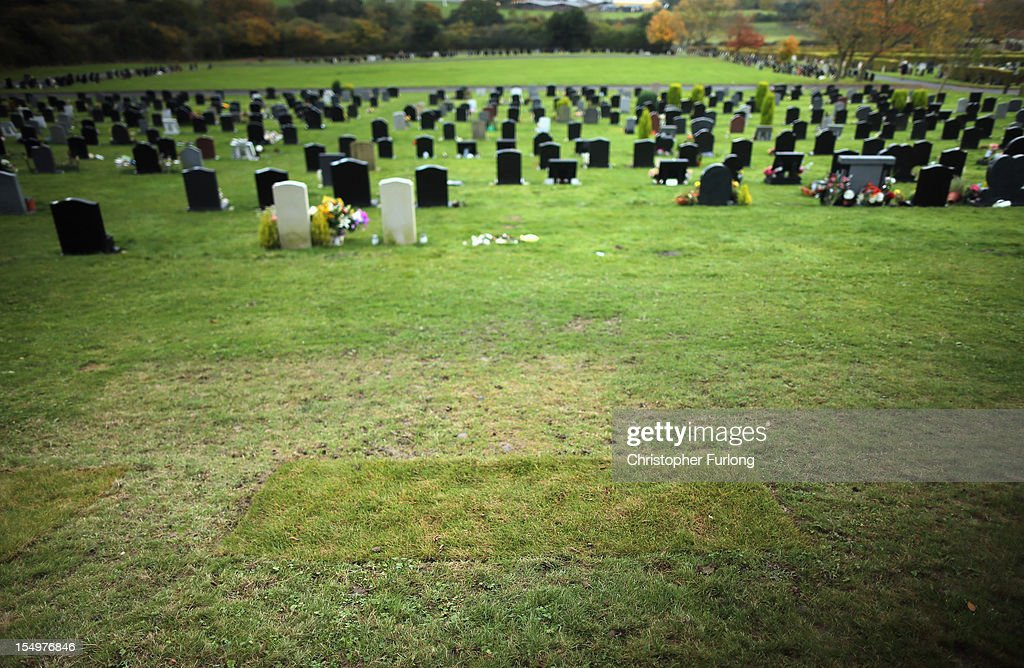 Recently laid turf is all that marks the grave of Jimmy Savile on the first anniversary of his death, at Woodlands Cemetery on October 29, 2012 in Scarborough, United Kingdom. An elaborate head stone was recently removed from the grave of the television personality Jimmy Savile due to fears it could be defaced. One year after the death of the television and radio presenter a UK wide investigation into alleged child abuse has been launched with many alleged victims coming forward.