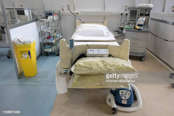 A recently prepared hospital bed and respirator are pictured inside the ExCel centre in London on March 30 which has been transformed into a field...