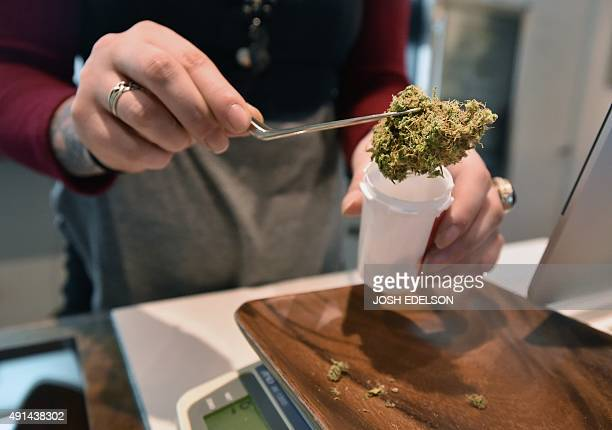 Recently purchased 'Hazy Kush' is moved from a scale at Farma a marijuana dispensary in Portland Oregon on October 4 2015 As of Oct 1 2015 limited...