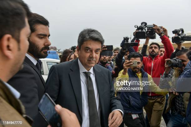 Recently resigned Pakistan's law and justice minister Mohammad Farogh Naseem leaves the Supreme Court building after a case hearing suspending the...