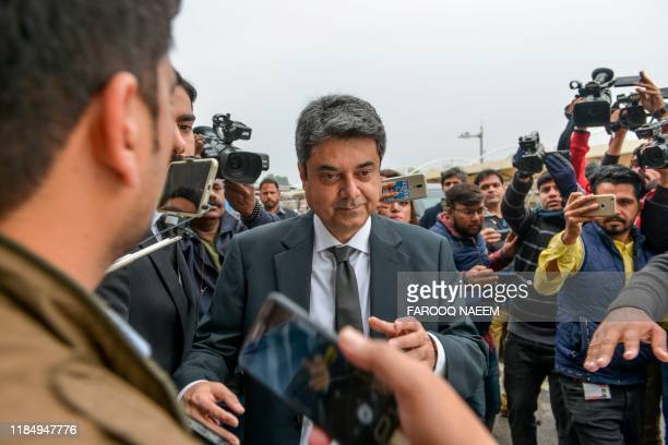 Recently resigned Pakistan's law and justice minister Mohammad Farogh Naseem leaves the Supreme Court building after a case hearingsuspending the...