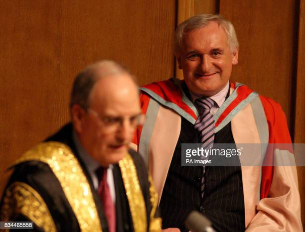 Recently retired Irish Taoiseach Bertie Ahern receives his honorary degree citation from Queen's University chancellor former US Senator George...