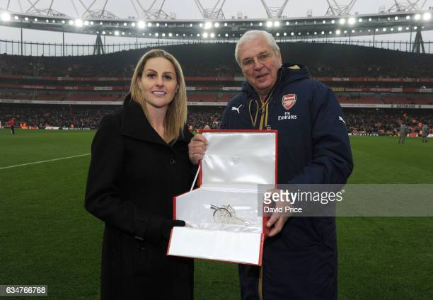 Recently retired Kelly Smith of Arsenal Ladies is presented with a Cannon by the Arsenal Chairman Sir Chip Keswick during half time at the Premier...