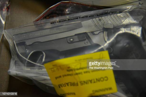 Recently seized guns are displayed as Mayor Muriel Bowser and Metropolitan Police Department Chief Cathy Lanier speak about the city's illegal guns...