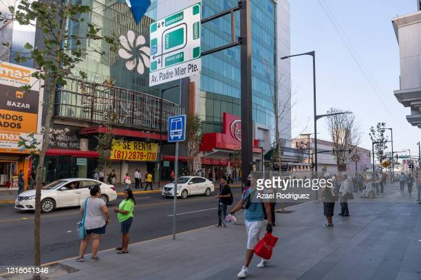 Recently upgraded sidewalks on Juarez avenue look relatively empty though still many people is seen both working and passing by in main downtown...