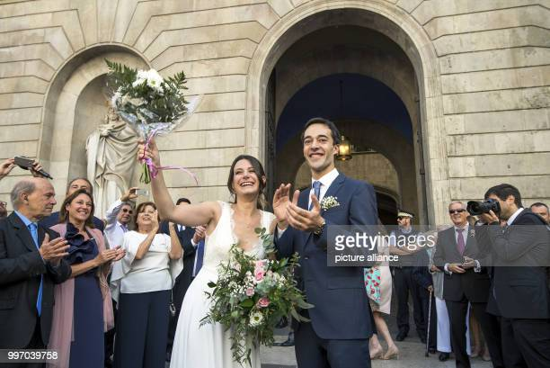 Recently wedded couple at a demonstration in favour of Spanish-Catalonian dialogue in the wake of the contentions independence referendum in Sant...