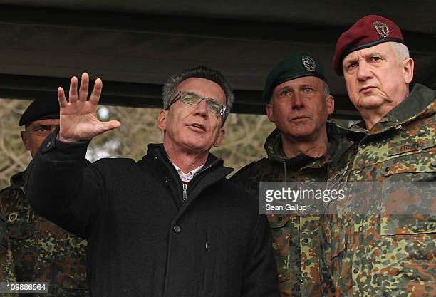 Recentlyappointed new German Defense Minister Thomas de Maiziere watches military exercises of the 37th Armoured Infantry Brigade at the Bundeswehr...