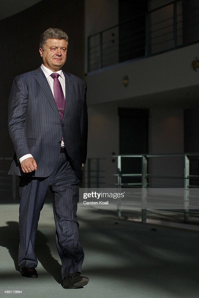 Recently-elected Ukrainian President Petro Poroshenko arrives together with German Chancellor Angela Merkel (not pictured) to give statements to the media prior to talks at the Chancellery on June 5, 2015 in Berlin, Germany. Poroshenko is meeting with western leaders as the situation in eastern Ukraine is descending further into war between government forces and Russian-backed separatists.