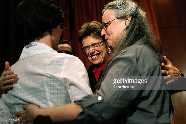 Recentlyreleased hiker Sarah Shourd is hugged by her mother Nora Shourd and mother of another imprisoned hiker Laura Fattal after a press conference...