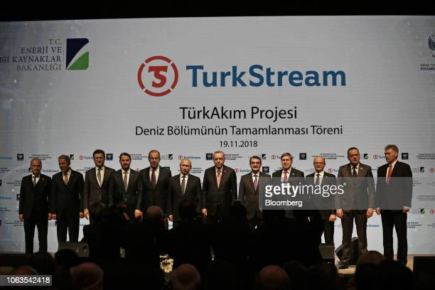 Recep Tayyip Erdogan Turkey's president center right Vladimir Putin Russia's president center left pose for a photograph with their ministers...