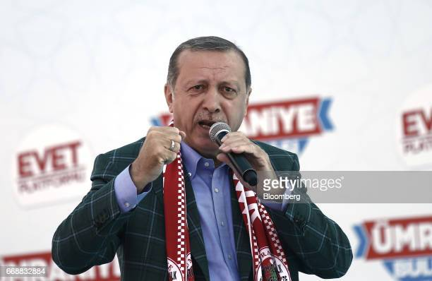 Recep Tayyip Erdogan Turkey's president gestures as he speaks to supporters during a 'Yes' referendum campaign rally in Umraniye Istanbul Turkey on...