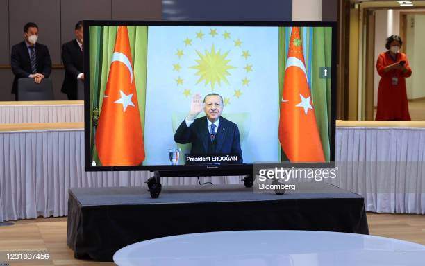 Recep Tayyip Erdogan, Turkey's president, gestures on a screen during a video link meeting with Charles Michel, president of the European Council,...