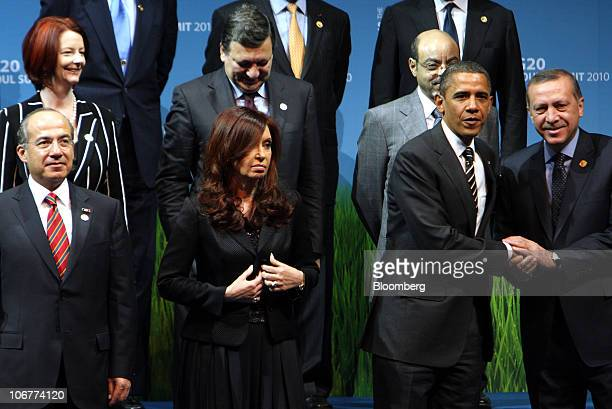 Recep Tayyip Erdogan Turkey's prime minister bottom right shakes hands with US President Barack Obama second from right during a group photo session...