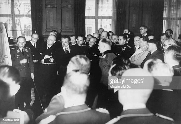 Reception at the Reich Chancellory in Berlin for the foreign delegations Major Eckhard Christian is reporting back from Hitler to the left Goering...
