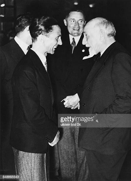 Reception at the Villa Borghese in Rome by the Fascist Syndicate of Italian freelance artists Joseph Goebbels in conversation with the writer Luigi...