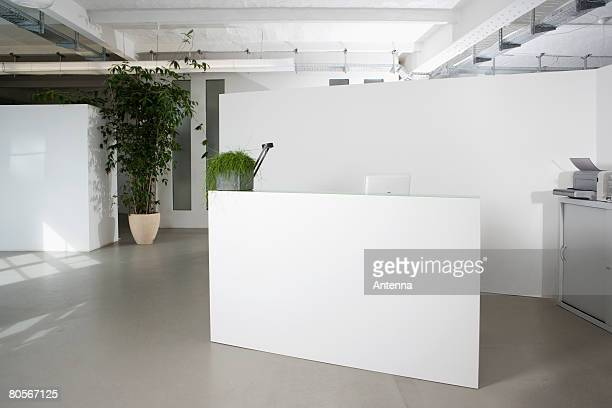 reception desk in the foyer of an office building - hotel lobby stock pictures, royalty-free photos & images