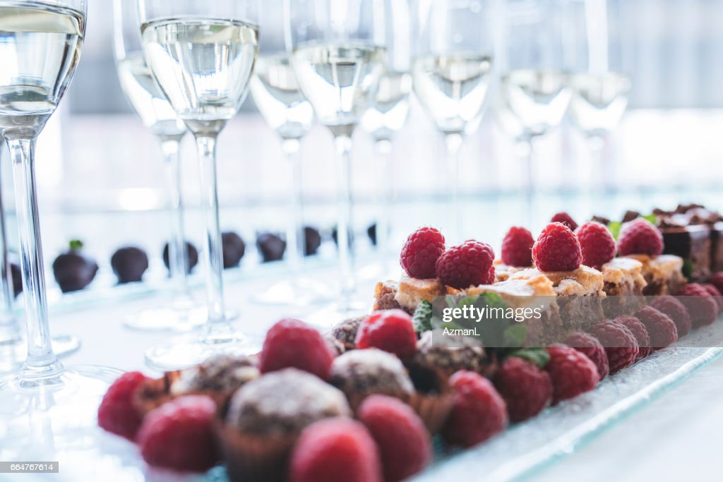 Reception drinks and sweets : Stock Photo