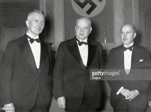 Reception for the former USPresident Herbert Hoover Left Hjalmar Schacht on the right the American ambassador in berlin R Hugh Wilson Photography...