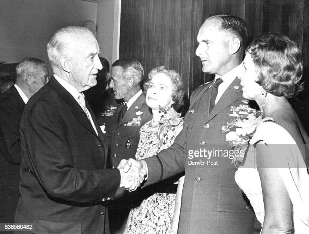 Reception Hosted for Generals Henry Van Schaack left greets Maj Gen and Mrs Robert Warren at Lowry Air Force Base reception In back are Gen and Mrs...