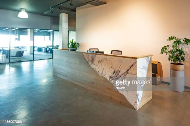 reception lobby area in a modern corporate business office - lobby stock pictures, royalty-free photos & images