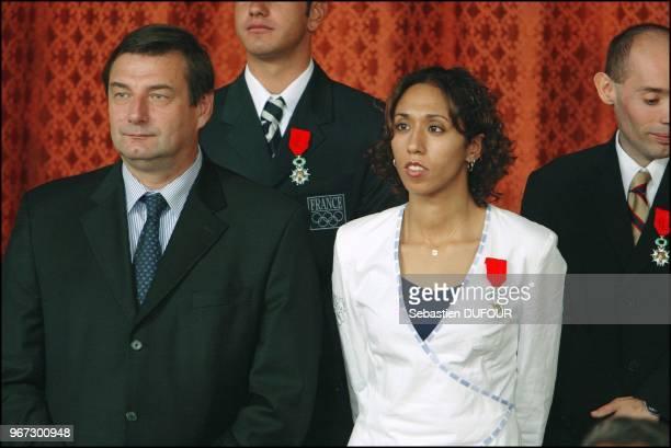 Reception offerte par Jacques Chirac en l honneur de la delegation Francaise aux jeux d'Athenes au palais de Elysee Mme Assia El Hannouni et le...