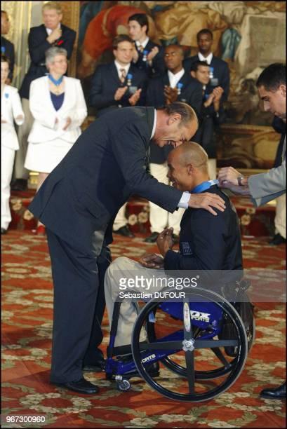Reception offerte par Jacques Chirac en l honneur de la delegation Francaise aux jeux d'Athenes au palais de Elysee Joel Jeannot commandeur de l odre...