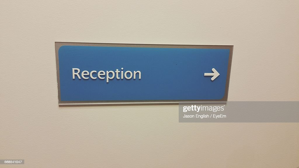 Reception Sign With Arrow On Wall : Stock Photo